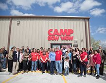 Camp Bow Wow Staff in front of Facility